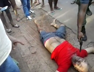 Momento da execução do mecânico: flagrante de celular