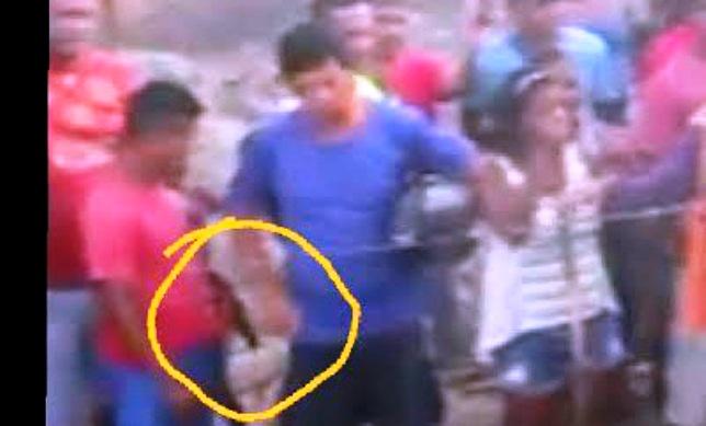 A imagem do vídeo mostra uma troca de objetos entre dois homens no terreno do Turu.. o que seria?!?