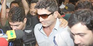 ...E o empresário após ser preso, em 2010